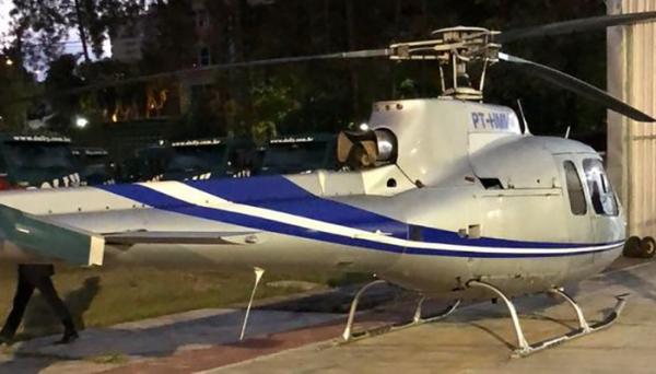 Um dos helicópteros apreendiso na operação que levou o dono da marca de refrigerantes Dolly à prisão (MPSP).