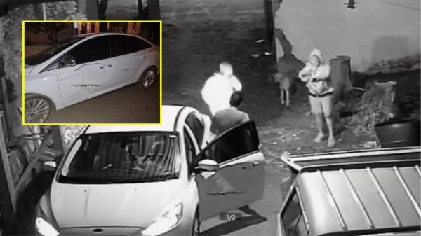 Momento em que o morador foi rendido pelos bandidos. Ford Focus levado pelos assaltantes tem amassado na porta (Divulgação).
